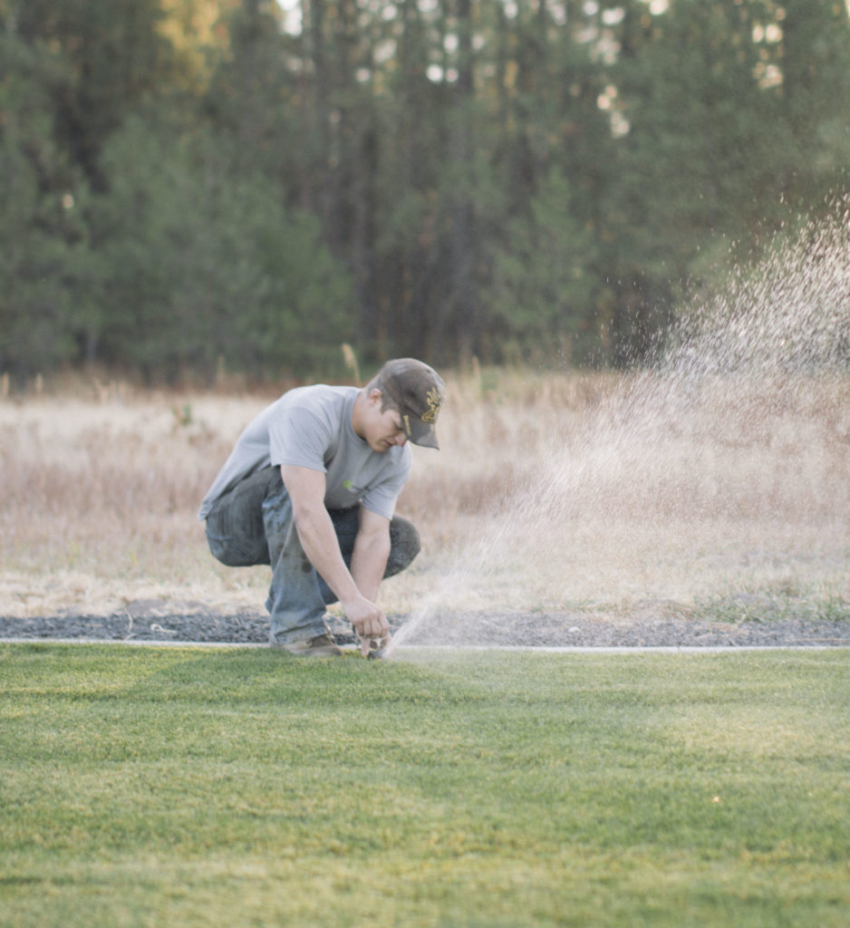 Sprinkler repair tech working on Spokane's South Hill.